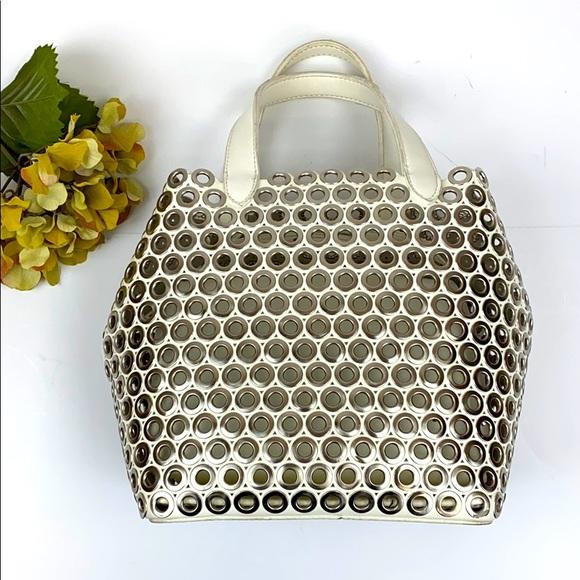 Metallic circle purse in Off white vegan leather